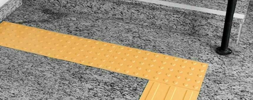 Tactile paving and traffic lights with a signal for visually impaired people
