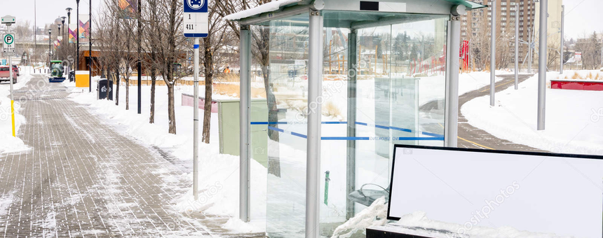 Bus stop glass shelter in Calgary, Canada. Photo: Radharc Images/Alamy Stock Photo